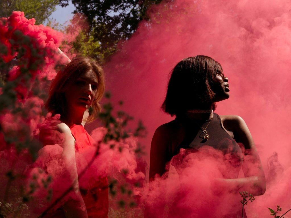 Women in the midst of red smoke
