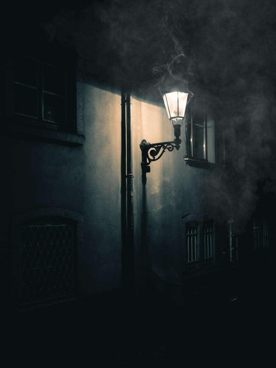 A burning gaslight in the night