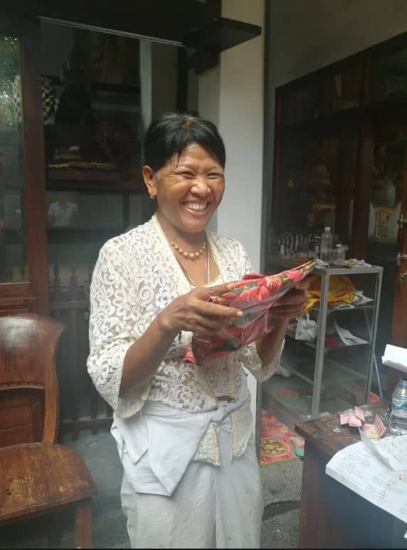 Wayan Nuriasih unwrapping a gift