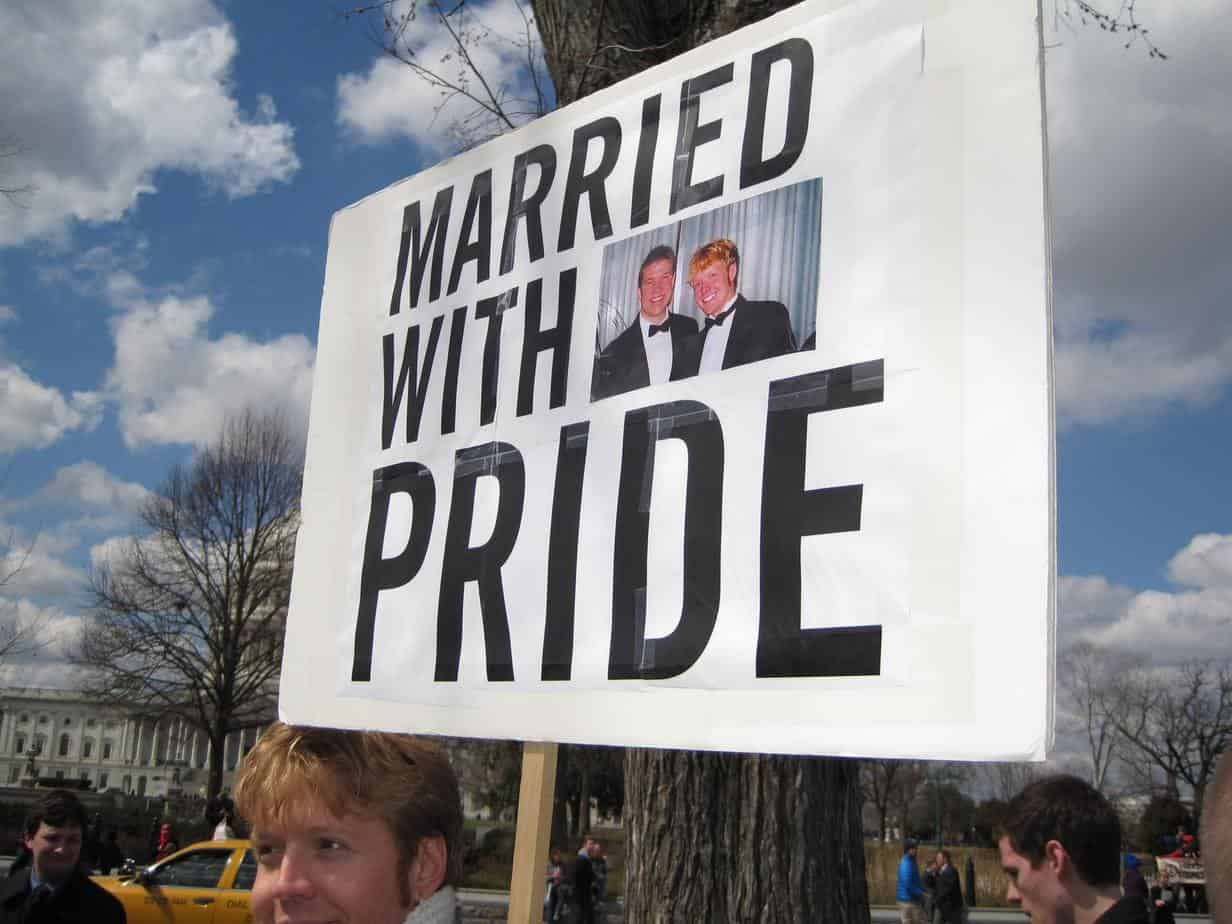 Sign saying married with pride