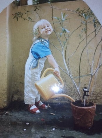 Bere watering a plant